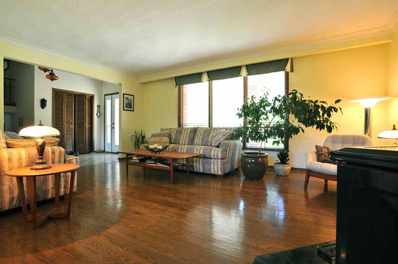 Living Room has hardwood floors, a wood-burning woodstove 