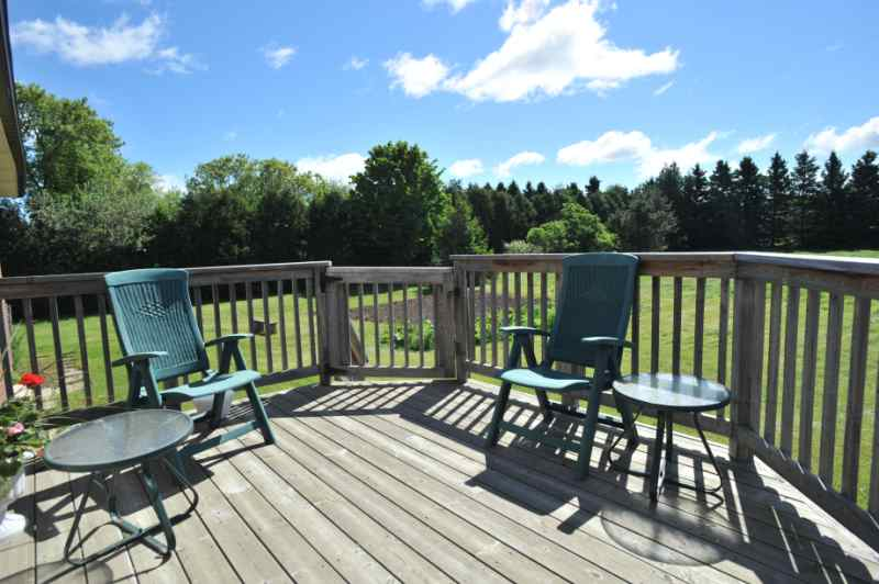 Deck off of kitchen - overlooking 2.5 Private Acres