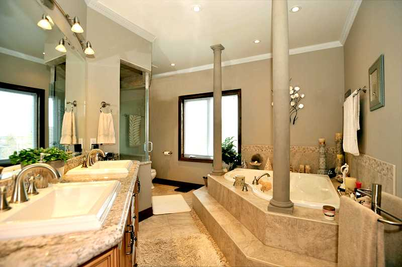 5-piece ensuite - jacuzzi tub, Luxor cabinets, crown mouldings and pillars