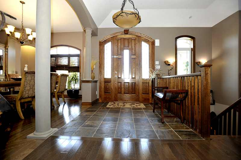 Foyer solid oak custom front doors and a slate floor