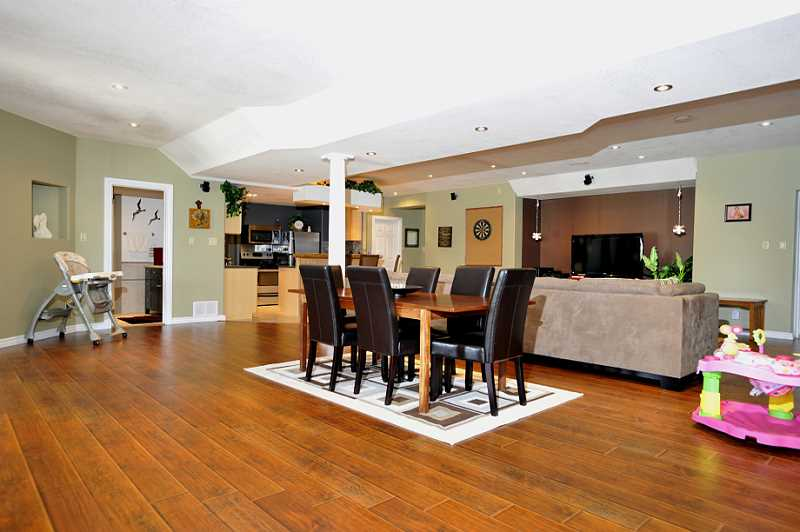 Open Concept Lower Level -  Kitchenette/bar with slate back-splash, fridge, stove & ceramic floor
