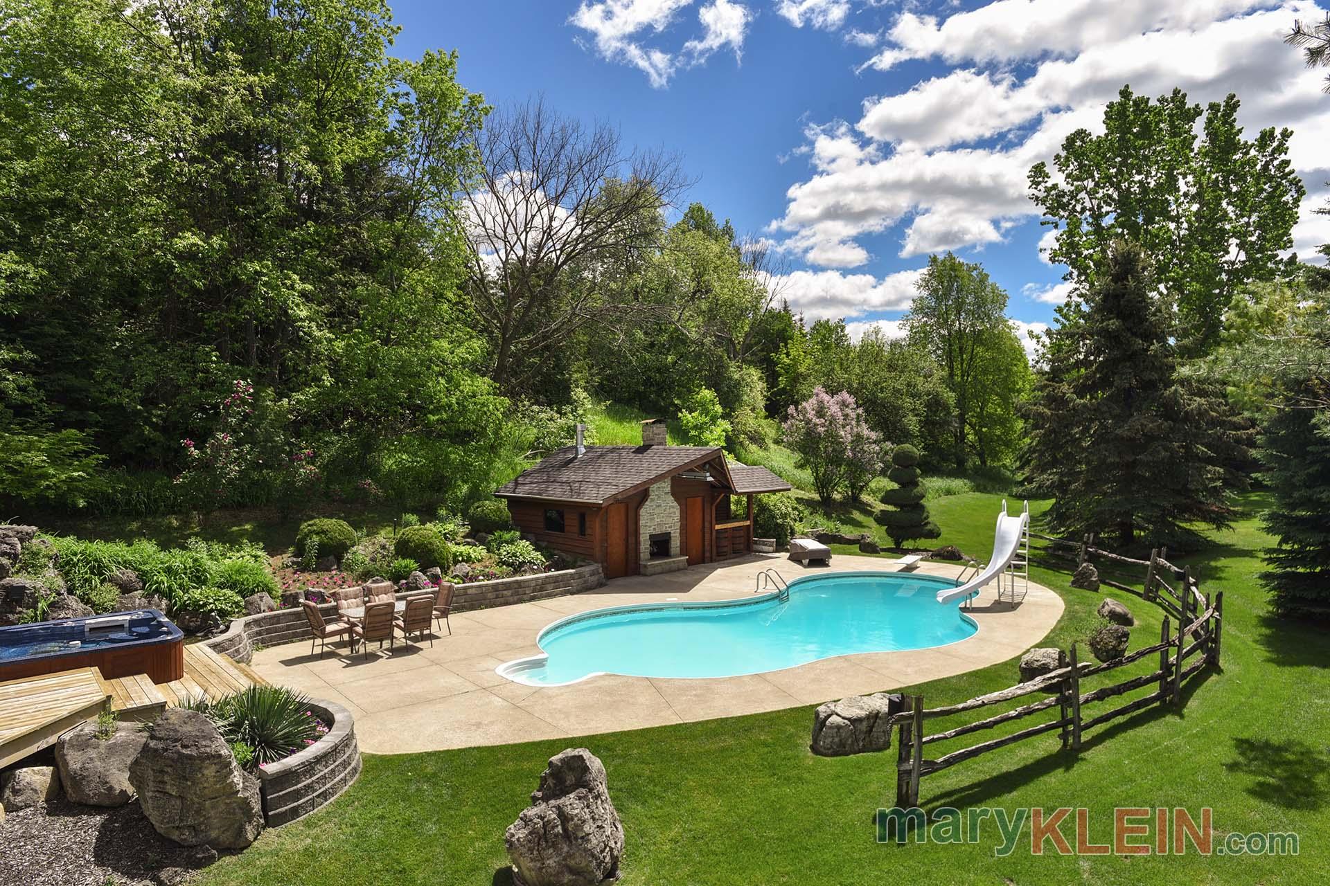 oasis, inground pool, hot tub, outdoor fireplace