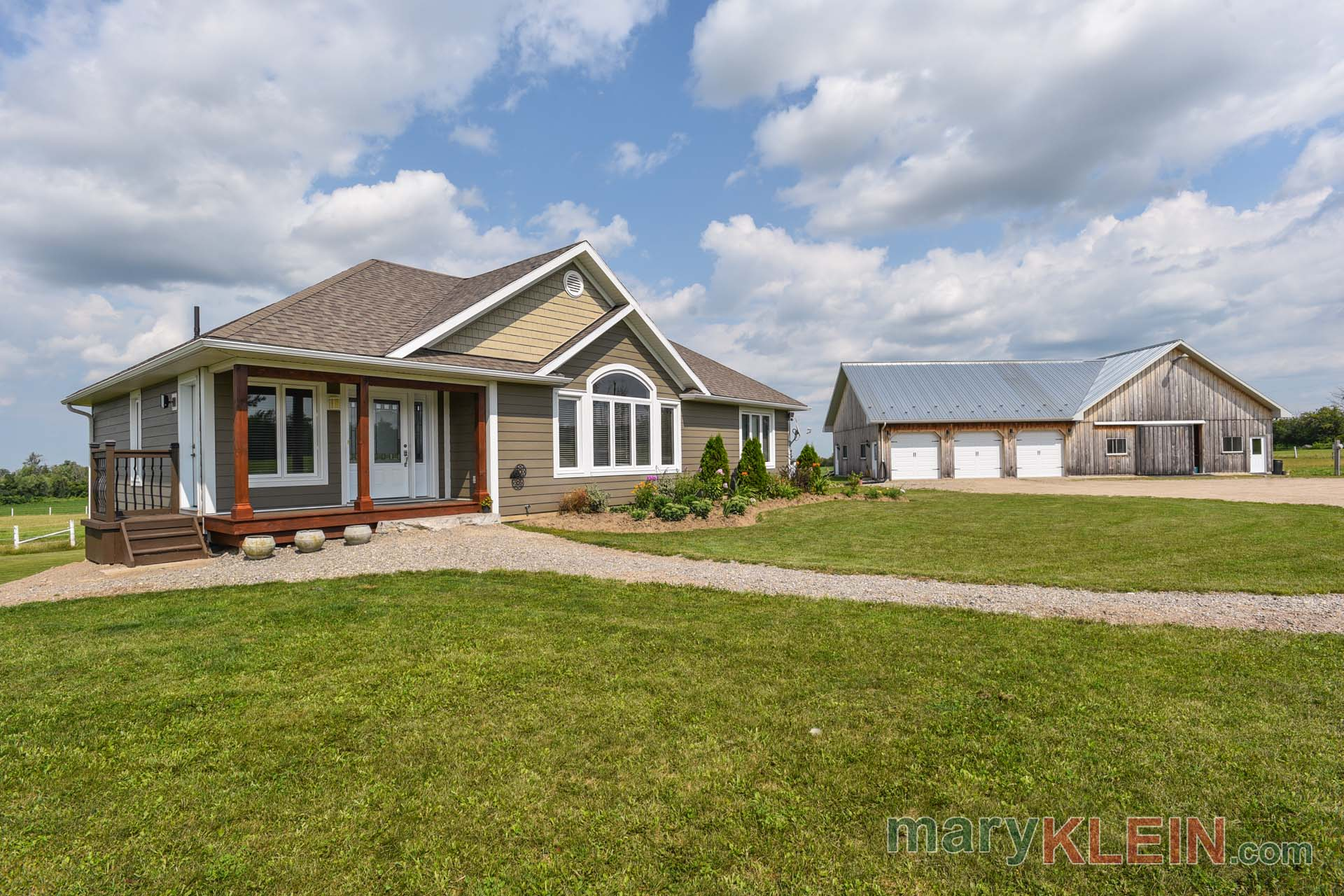 Newer Bungalow, 6 stall barn, workshop, 3 car garage