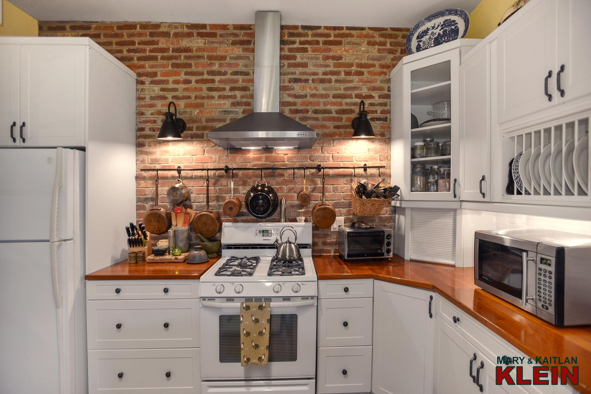 Kitchen, exposed brick wall