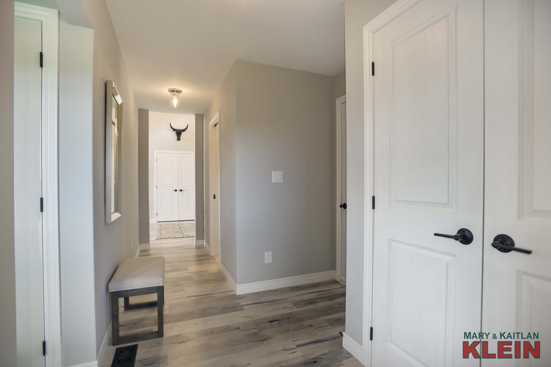 Garage Access, Double Closet, Laundry and 2-Piece Bathroom