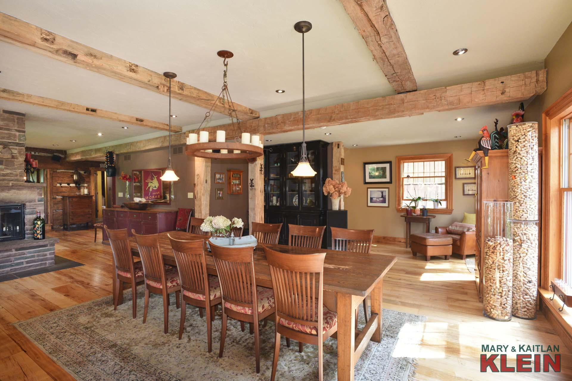 Open concept dining room, stone wood burning fireplace